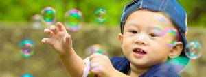 baby boy playing with bubbles